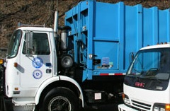 A blue and white dumpster truck