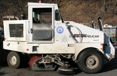 A white, single cab, street sweeper